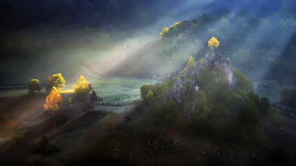 Transylvania village ,sunrise with fog in autumn time