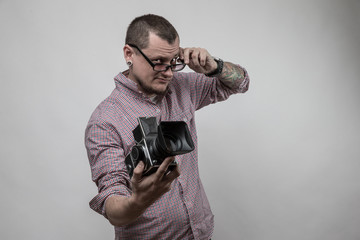 man with camera and glasses