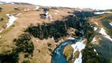 Schlucht mit Wasserfall in Island - 248043972