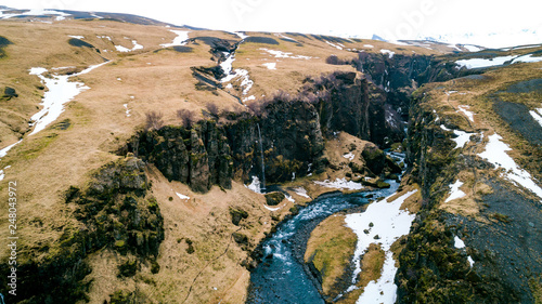 Leinwanddruck Bild Schlucht mit Wasserfall in Island