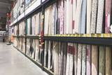Many different colored wallpapers in the supermarket showcase. Choice of wallpapers in a warehouse. Background. Copyspace. Department of wallpaper in the supermarket - 248059597