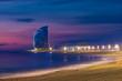 Leinwanddruck Bild - Barcelona Beach in summer night along seaside in Barcelona, Spain. Mediterranean Sea in Spain.