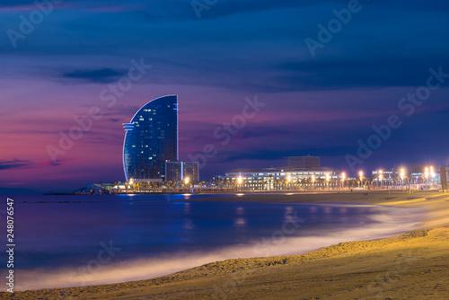 Leinwanddruck Bild Barcelona Beach in summer night along seaside in Barcelona, Spain. Mediterranean Sea in Spain.