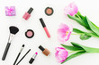 Leinwanddruck Bild - Beauty composition with pink tulips bouquet and cosmetics on white background. Top view. Flat lay.