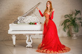 Lady in gorgeous red long evening chiffon dress, fashionable romantic trend for ladies
