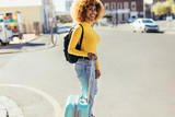 Tourist woman crossing the street holding luggage - 248127556