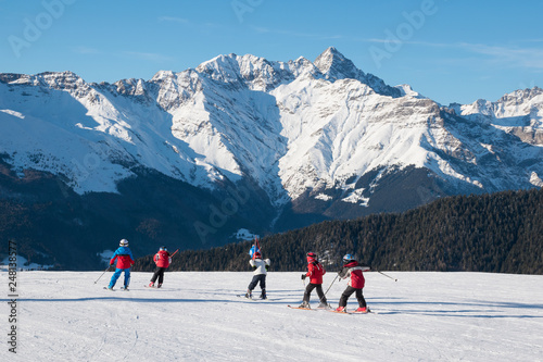 fototapeta na ścianę Children skiers in action on the ski slopes of Spiazzi di Gromo, Val Seriana, Lombardy, Italy