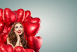 Beautiful woman with red balloons on banner background. Surprised girl, Valentine's day concept . Expressive facial expressions - 248140319