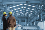 production engineer working in  commercial business building with the structural steel structure - 248149180