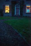 Illuminated window of house in twilight. - 248156503