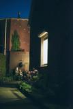 Illuminated window of house in the night. - 248156517