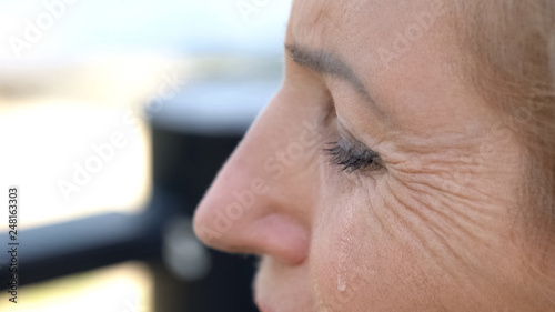 Leinwanddruck Bild Old woman crying, relationship difficulties, pain of betrayal, domestic violence