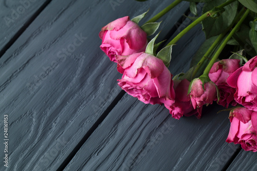 delicate roses on wooden background