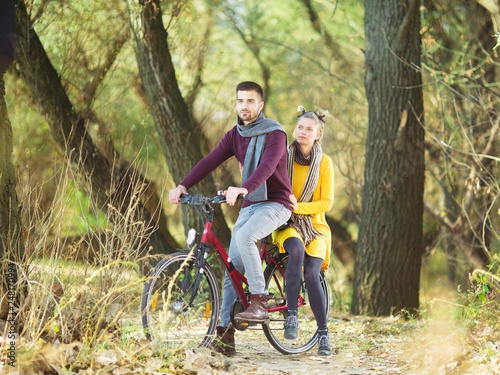 Young couple on bicycle in nature