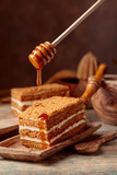 Homemade layered honey cake with cream.