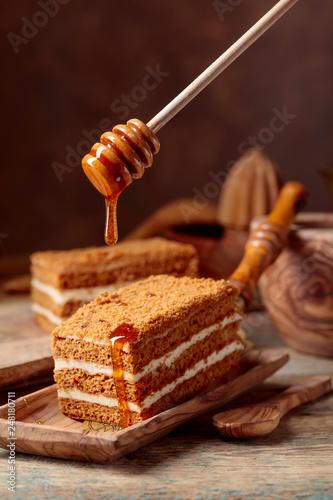 Homemade layered honey cake with cream.