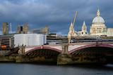 london bridge and constructions against blue sky