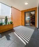 Rooftop terrace with marble flooring and shadow of wooden beams - 248184744