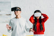 interracial couple having fun by using virtual reality headsets