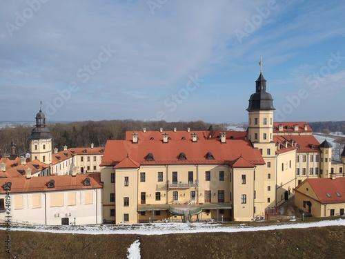 fototapeta na ścianę Aerial view of Nesvizh Castle in winter. Minsk Region, Belarus. Site of residential castle of the Radziwill family.