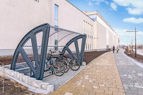 KRAKOW, POLAND - JANUARY 20, 2018: Bike station at The Jagiellonian University. Modern campus buildings
