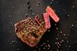 Leinwanddruck Bild - Restaurant cooking art. Grilled steak sliced on textured black background.