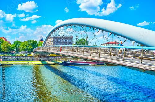 The modern footbridge across Vistula River in Krakow, Poland
