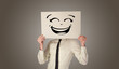 Casual person holding a paper in front of his face with drawn emoticon face