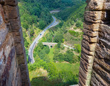 Small stone bridge on the Lot towards Saint-Julien-du-Tournel, Lozere, Occitanie.