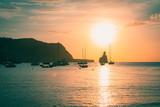 Quiet scene: Sailboats in a harbor at sunset. Mediterranean sea of Ibiza island, cala benirras and Murada island. - 248209732