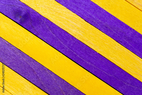 Yellow diagonal colored wooden background with purple stripes - 248215739