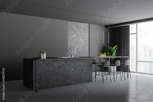 Gray and stone kitchen corner with bar - 248219767