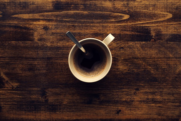Cup of coffee on table, top view