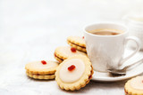 Empire shortbread sandwich cookies and cup of coffee - 248235168