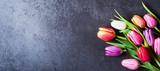 Tulips bouquet on dark grey background