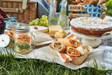 Delicious picnic food served outdoors on a rug - 248240967