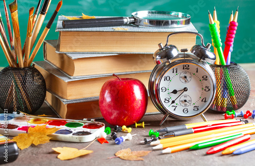 Foto Murales Back to school. School subjects for study, rotate on the table.