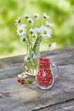Charming still life with copy space strawberries and daisies - 248251330
