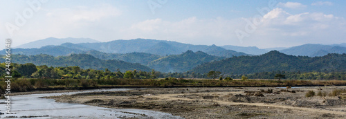 banner landscape of river curving  through the countryside with mountains in the background in Mandalay District, Myanmar - 248266748