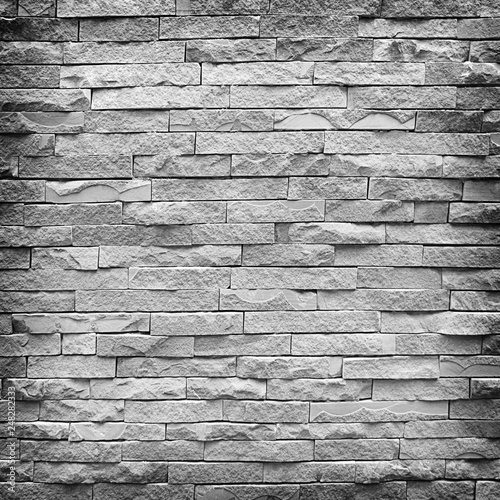 Gray brick wall as a background or texture - 248282333