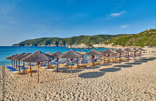 Foto Murales Beach with loungers and umbrellas in Greece