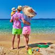 Leinwandbild Motiv Family on beach in Greece. Summer vacation.