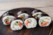 Japanese sushi on wooden plate, food background