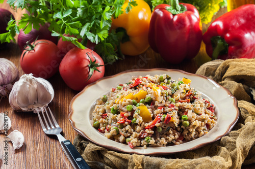 Leinwandbild Motiv Bulgur salad with vegetables