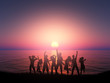 3D silhouette of people dancing against a sunset ocean landscape