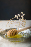 spoon with honey bee on a plate