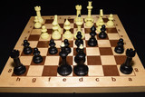 Wooden chess board under the pawns like a game theme