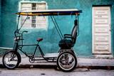 Rikscha vor einem Haus in Havanna Kuba
