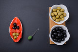 olives and black olives in a bowl and ginger - 248341104