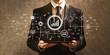 Leinwanddruck Bild - Marketing concept with businessman holding a tablet computer on a dark vintage background